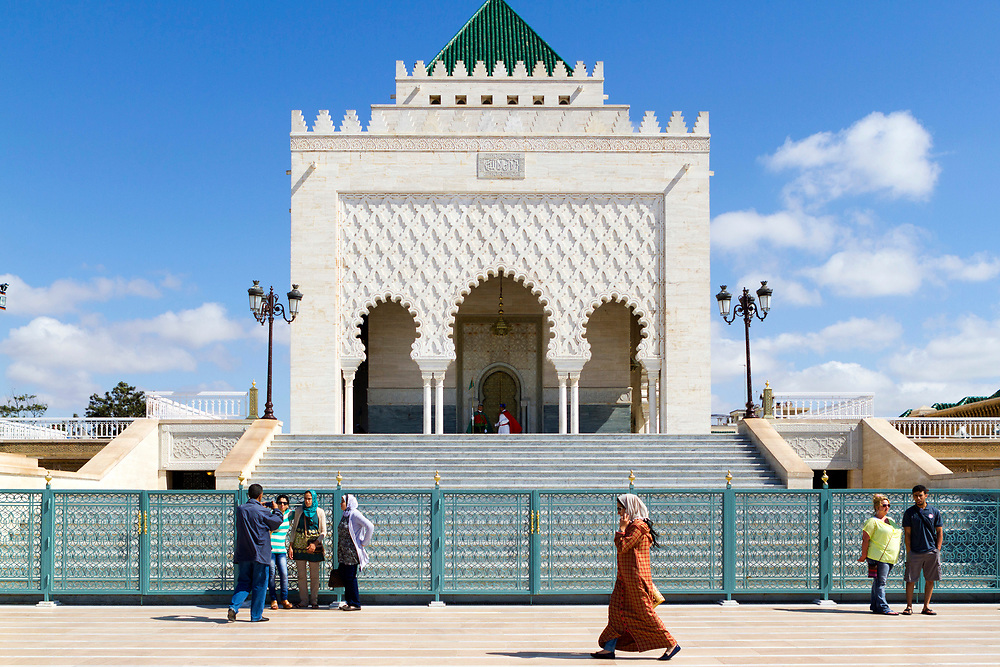 RABAT, MOROCCO - 27th May 2014 - Tourists stand for their photograph to be taken at the entrance of the Mausoleum of Mohammed V in Yacoub al-Mansour esplanade in Rabat, Morocco.