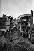 12/06/1963<br /> 06/12/1963<br /> 12 June 1963<br /> Houses collapse at 3/4 Fenian Street, Dublin. Firefighters sift through the rubble. Two young girls, Marie Vardy (9) and Linda Byrne (8), were killed in the collapse and one man, Andrew Dent, jumped for his life from the collapsing building.
