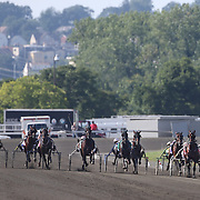 Driver Brian Sears and Royalty For Life (second from the right) winning the $1.2 million Hambletonian final for 3-year-old trotters on at The Meadowlands Harness Racetrack, East Rutherford, New Jersey, USA.  3rd August 2013. Photo Tim Clayton