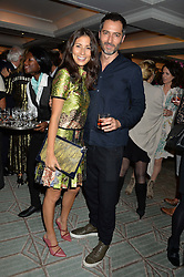 JASMINE HEMSLEY and NICK HOPPER at a party hosted by Ewan Venters CEO of Fortnum & Mason to celebrate the launch of The Cook Book by Tom Parker Bowles held at Fortnum & Mason, 181 Piccadilly, London on 18th October 2016.