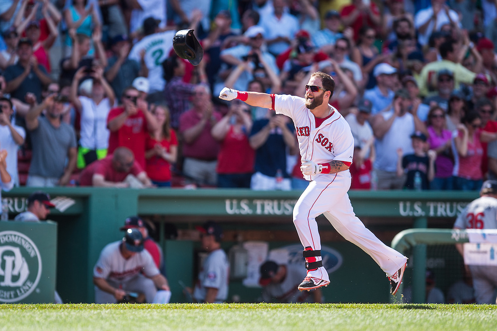 BOSTON, MA - JUNE 18: Mike Napoli #12 of the Boston Red Sox reacts by tossing his helmet after hitting a walk off home run in the bottom of the 10th inning during the game against the Minnesota Twins at Fenway Park in Boston, Massachusetts on June 18, 2014. (Photo by Rob Tringali) *** Local Caption *** Mike Napoli
