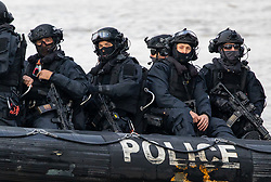 © Licensed to London News Pictures. 24/10/2018. London, UK. A police boat patrol ahead of a Royal Marine Commandos demonstration on the River Thames as part of the state visit by Dutch Royals King Willem-Alexander and Queen Maxima. Photo credit : Tom Nicholson/LNP