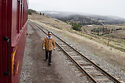 Railroad Brakeman Lucas Maez keeps a watchful eye on the Cumbres & Toltec during it's first run of the season.