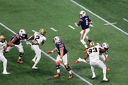 Auburn Tigers quarterback Jarrett Stidham (8) rolls out on a pass play during the 2018 Chick-fil-A Peach Bowl NCAA football game on Monday, January 1, 2018 in Atlanta. (Daniel Shirey / Abell Images for the Chick-fil-A Peach Bowl)