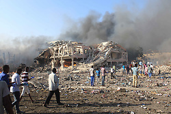 Oct. 14, 2017 - Mogadishu, Somalia - The explosion site near Safari hotel in Mogadishu, capital of Somalia. The death toll from twin bombing attacks in Somalia's capital rose to more than 200 on Sunday, a minister said, as emergency crews pulled more bodies from burned cars and demolished buildings after the Saturday blasts.(Credit Image: © Faisal Isse/Xinhua via ZUMA Wire)