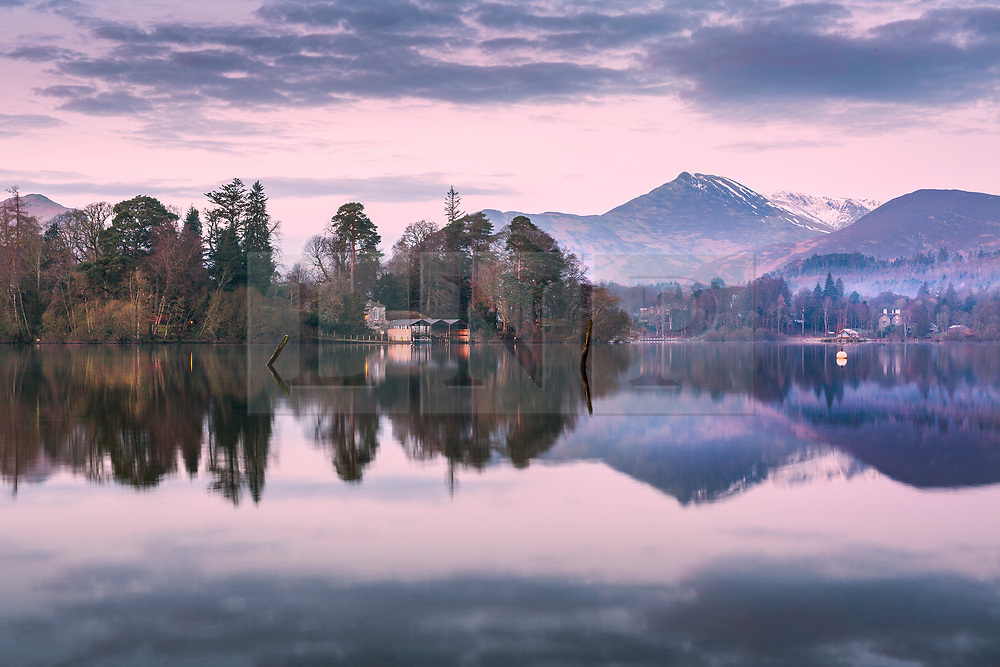 © Licensed to London News Pictures. 06/03/2020. KeswickUK. Derwent Isle & the surrounding mountains reflect into the calm water of Derwentwater lake at dawn this morning in Cumbria. Photo credit: Andrew McCaren/LNP