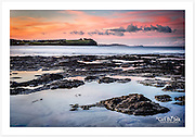 Sunset on a calm afternoon at Flat Rock near Ballina, looking towards Cape Byron in the distance [Ballina, NSW]<br />
