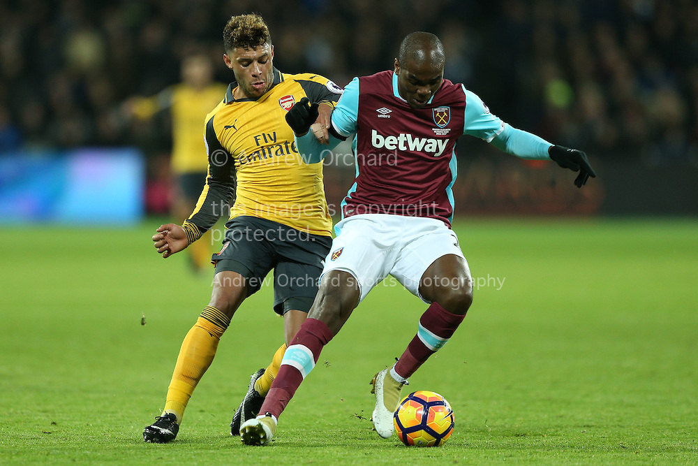 Alex Oxlade-Chamberlain of Arsenal intercepts Alvaro Arbeloa of West Ham United.Premier league match, West Ham Utd v Arsenal at the London Stadium, Queen Elizabeth Olympic Park in London on Saturday 3rd December 2016.<br /> pic by John Patrick Fletcher, Andrew Orchard sports photography.