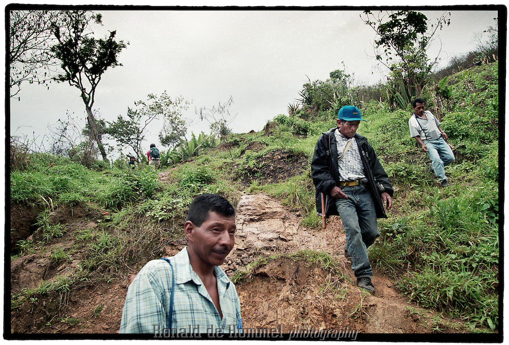 Three members of the guardia Indigena, a civil guard in the mountains of the Colombian southern province of Cauca on partol in the Toribio area. The guards try to keep a precarious balance amongst the fighting parties in the region: paramilitaries, FARC guerrilla and the government troops., 2003 Cauca province, southern Colombia