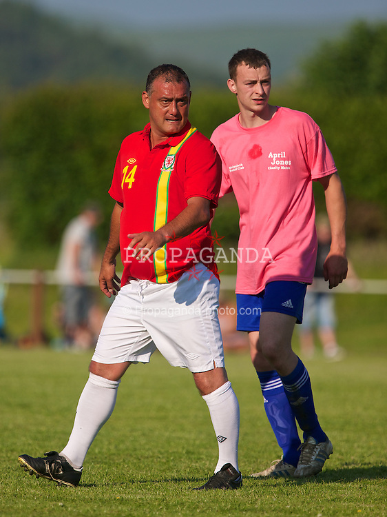 MACHYNLLETH, WALES - Tuesday, July 9, 2013: Wales' Malcolm Allen in action against Machynlleth FC during a charity football match in aid of the April Jones Fund. (Pic by David Rawcliffe/Propaganda)