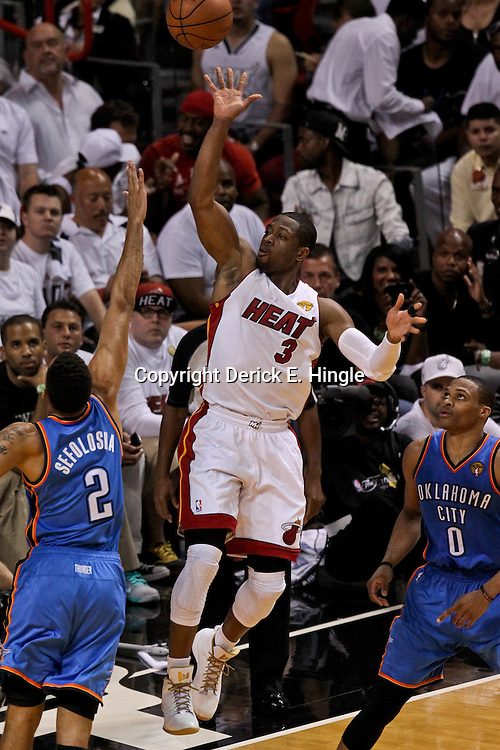 Jun 21, 2012; Miami, FL, USA; Miami Heat shooting guard Dwyane Wade (3) shoots over Oklahoma City Thunder shooting guard Thabo Sefolosha (2) during the third quarter in game five in the 2012 NBA Finals at the American Airlines Arena. Mandatory Credit: Derick E. Hingle-US PRESSWIRE