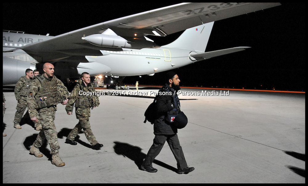 MOD Imam Asim Hafiz gets off the plane with British Troops as they arrive at Camp Bastion in Afghanistan in the early hours of the 17th January 2014 . Picture by Andrew Parsons / Parsons Media Ltd