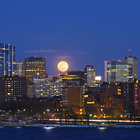 On 12 March 2017, I ventured out into Boston to photograph the full moon rising across its iconic skyline. It was a bitter cold night in the single digits. Usually there are plenty of bikers, walkers and runners but not on this frigid night. I also noted no other photographers which made me wonder a little bit about myself. In this photograph, I selected a tighter and more intimate composition to capture the moon with the newly constructed Millennium Tower, one of Boston's new landmarks. <br />