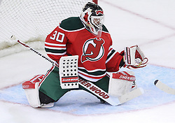 Mar 17; Newark, NJ, USA; New Jersey Devils goalie Martin Brodeur (30) makes a glove save during the first period of their game against the Pittsburgh Penguins at the Prudential Center.