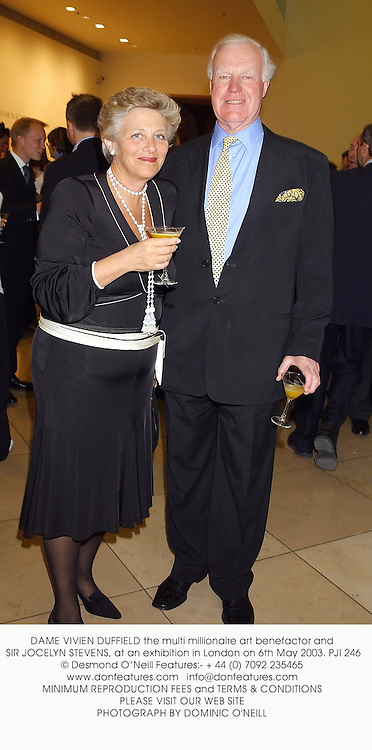 DAME VIVIEN DUFFIELD the multi millionaire art benefactor and SIR JOCELYN STEVENS, at an exhibition in London on 6th May 2003.	PJI 246