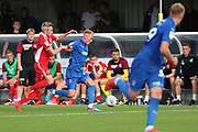 AFC Wimbledon midfielder Mitchell (Mitch) Pinnock (11) battles for possession with Scunthorpe United midfielder Matthew Lund (7) during the EFL Sky Bet League 1 match between AFC Wimbledon and Scunthorpe United at the Cherry Red Records Stadium, Kingston, England on 15 September 2018.
