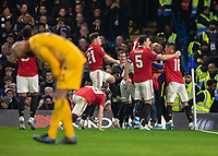 Football - 2019 / 2020 EFL Carabao (League) Cup - Fourth Round: Chelsea vs. Manchester United<br /> <br /> Manchester United players celebrate after Marcus Rashford (Manchester United) restores their lead as Wilfredo Caballero (Chelsea FC) looks dejected at Stamford Bridge <br /> <br /> COLORSPORT/DANIEL BEARHAM