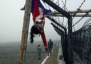 Caption of the pix ---  Teenaged girl, Felani Khatun was hanging on the International Barbed Wire Border Fence on India-Bangladesh International Border, who was shot by International Border Gurad –  Border Security Force of India (BSFI) on 07th january, 2011, during illegally cross the aforesaid international border, with her father Nuru Islam Nuru, the resident of Kalonitari (as publicly known as – Banarbhita) village of Dakhhin (that is, Southern part of) Ramkhana area under Nageshwari Upozela of Kurigram district of Bangladesh, who escaped safely. Pic-Shib Shankar Chatterjee, (All pics are copyright protected, do not use without permission, otherwise will face punishment as per cyber and others act/law at international court…so be careful)
