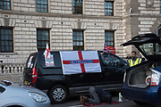 Minicab driver praying whileprotesing about the congestion charge Parliament Sq. , London. 11 March 2019