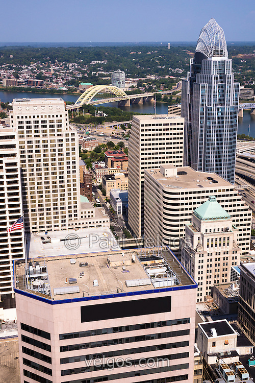 Picture of Cincinnati aerial skyline of downtown city buildings, bridges, Ohio river, and sports stadiums including Great American Ballpark, Great American Insurance Group Tower, US Bank building, and Scripps Center building. High resolution vertical photo was taken in July 2012.