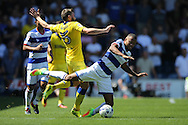 Jordan Cousins of QPR is pushed over by Stuart Dallas of Leeds United. Skybet EFL championship match, Queens Park Rangers v Leeds United at Loftus Road Stadium in London on Sunday 7th August 2016.<br /> pic by John Patrick Fletcher, Andrew Orchard sports photography.