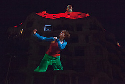 "© Licensed to London News Pictures. 1 December 2012. Barcelona, Spain. Show ""Emocions en moviment"" with 8 live dancers and their images on the façade of La Pedrera. In 1912, La Pedrera (Casa Mila), Barcelona's iconic landmark by architect Antoni Gaudi was finished  To celebrate 100 years of La Pedrera, Barcelona citizens were treated to a free tour of the building where 150 dancers and musicians performed around every corner and on the roof. Later, images were projected onto the façade of the building with live dancers interacting with them. Photo credit: Bettina Strenske/LNP"