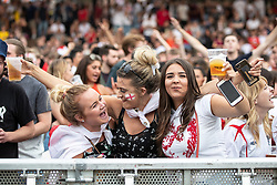 © Licensed to London News Pictures . 11/07/2018. Manchester, UK. Football fans watch England play against Croatia in the World Cup semi finals, on a big screen at Castlefield Bowl in Manchester City Centre . Until today , Manchester had been the largest city in England not to be showing World Cup matches to the public on a big screen . Photo credit: Joel Goodman/LNP