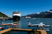 Float planes take off from Gastineau Chanel in front of cruise ships in downtown Juneau, Alaska, May 26, 2017. <br /> Photo by David Lienemann