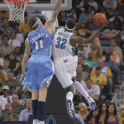 25 March 2009: New Orleans Hornets forward Julian Wright (32) shoots over Denver Nuggets center Chris Andersen (11) during a NBA game between the New Orleans Hornets and the Denver Nuggets at the New Orleans Arena in New Orleans, Louisiana.