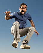 """Comedian and actor Aziz Anwari poses for a portrait backstage at the Sasquatch Music Festival on May 29th, 2009. Gear: Nikon D700, 24-120mm Lens, Speedotron Black Line 1205cx, 22"""" Speedotron beauty dish with with 30 degree grid for highlight."""