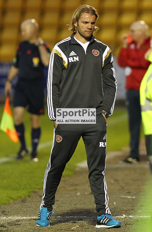 A Glum looking Robbie Neilson after watching  his team getting  knocked out of  the Petrofac Training Cup ..... ©Edward Linton | SportPix.org.uk