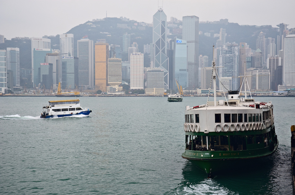 Star ferry pulling out from Tsim Sha Tsui, with Hong Kong skyline and Victoria Harbour in view