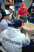 Native American musicians playing drum at Pow Wow.  Mendota Heights  Minnesota USA