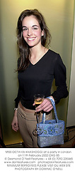 MISS OCTAVIA KHASHOGGI at a party in London on 11th February 2002.			OXG 85