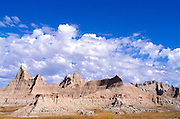 Blue sky and clouds over eroded spires in the badlands near Cedar Pass, Badlands National Park, South Dakota
