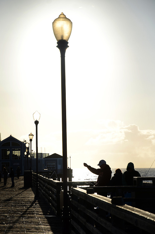 Silhouette of fishermen on Oceanside Pier, Oceanside, CA. USA