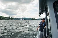 Dept of Safety Marine Patrol Captain Tim Dunleavy patrols around Governors Island on Lake Winnipesaukee Thursday afternoon.  (Karen Bobotas/for the Laconia Daily Sun)