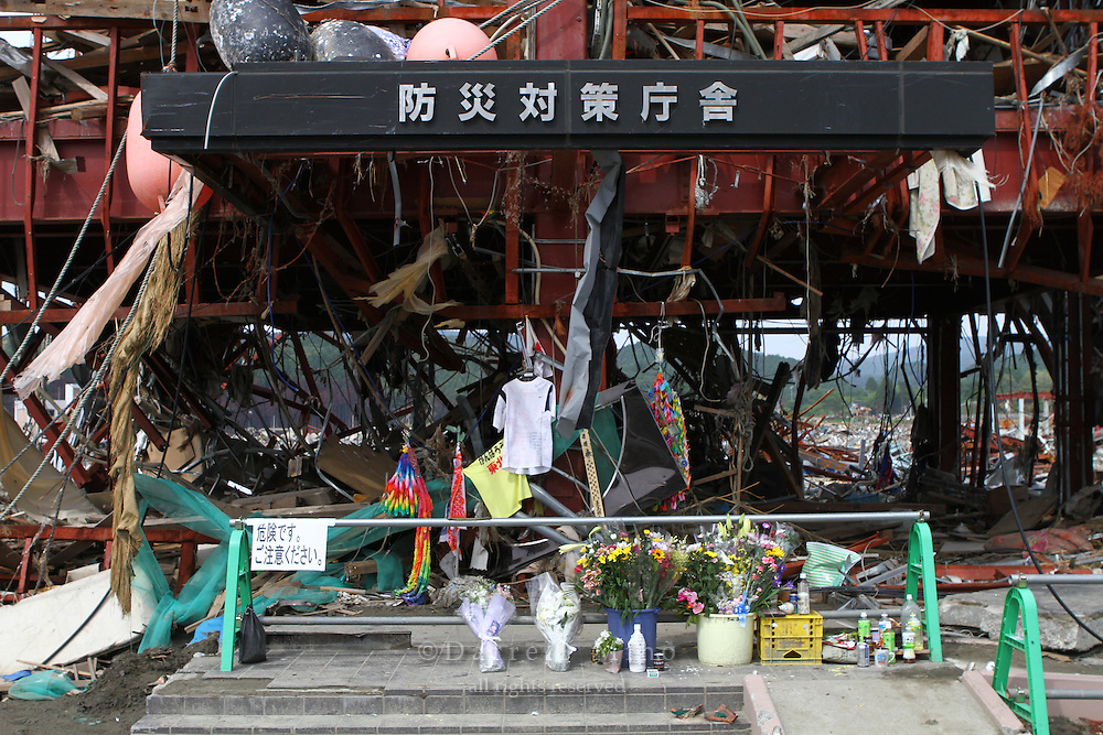 June 12, 2011; Minamisanriku, Miyagi Pref., Japan - Memorial in front  of the Crisis Management Department (Bousai Taisaku Chousha) after the magnitude 9.0 Great East Japan Earthquake and Tsunami that devastated the Tohoku region of Japan on March 11, 2011.