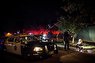 FRESNO, CA - NOVEMBER 16. Officers with the Fresno Police Department respond to a domestic disturbance call.
