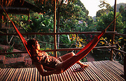 Woman rests in a hammock in Cambodia, 2009.