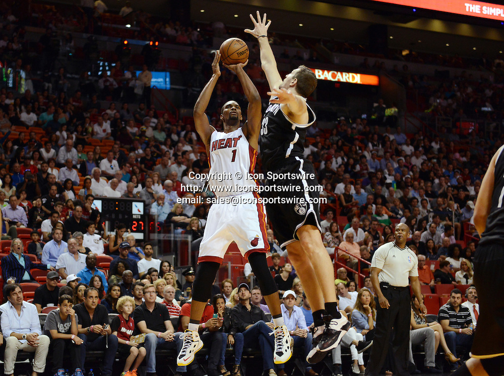 Jan. 4, 2015 - Miami, FL, USA - Miami Heat's Chris Bosh puts up a shot over Brooklyn Nets' Mirza Teletovic on Sunday, Jan. 4, 2015, at AmericanAirlines Arena in Miami