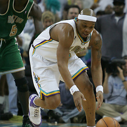 Bonzi Wells #24 of the New Orleans Hornets picks up a loose ball against the Boston Celtics in the third quarter of their NBA game on March 22, 2008 at the New Orleans Arena in New Orleans, Louisiana. The New Orleans Hornets defeated the Boston Celtics 113-106.