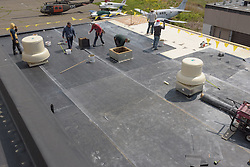 Roof Replacement and Mechanical Upgrades Stratford School For Aviation Maintenance Technicians.  Project No: BI-RT-860<br /> Contractor: Silktown Roofing, Manchester CT.<br /> James R Anderson Photography   New Haven CT   photog.com<br /> Date of Photograph: 15 May 2014<br /> Camera View: Southwest, Roof B  Image No. 26