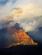 A winter storm engulfs Buddha Temple and Sturdevant Point in the Grand Canyon.