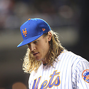NEW YORK, NEW YORK - October 5: Pitcher Noah Syndergaard #34 of the New York Mets returns to the dugout after pitching during the San Francisco Giants Vs New York Mets National League Wild Card game at Citi Field on October 5, 2016 in New York City. (Photo by Tim Clayton/Corbis via Getty Images)