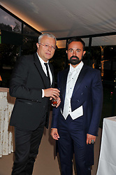 Left to right, ALEXANDER LEBEDEV and his son EVGENY LEBEDEV at the Raisa Gorbachev Foundation Gala held at the Stud House, Hampton Court, Surrey on 22nd September 22 2011