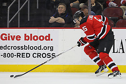 Feb 2; Newark, NJ, USA; New Jersey Devils defenseman Adam Larsson (5) skates with the puck during the third period at the Prudential Center. The Devils defeated the Canadiens 5-3.