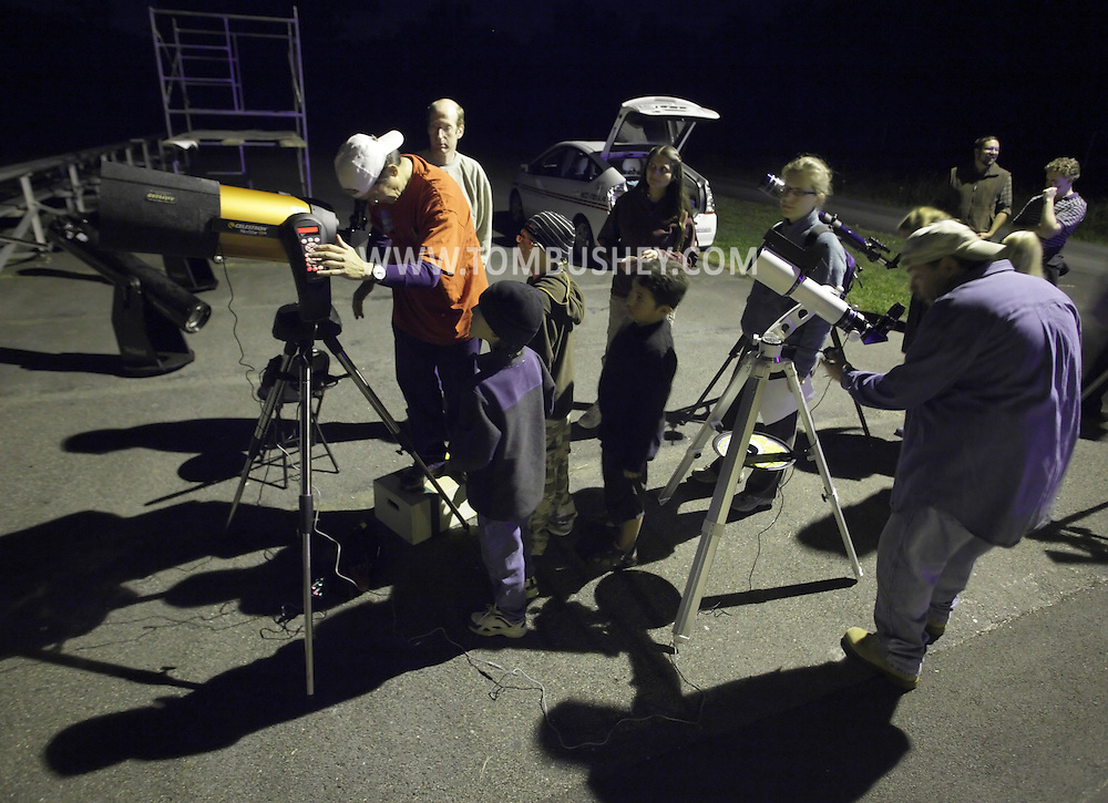 New Paltz, New York - Members of the Mid-Hudson Astronomical Association set up telescopes for International Observe the Moon Night at Smolen Observatory at SUNY New Paltz on Sept. 18, 2010. ©Tom Bushey / The Image Works