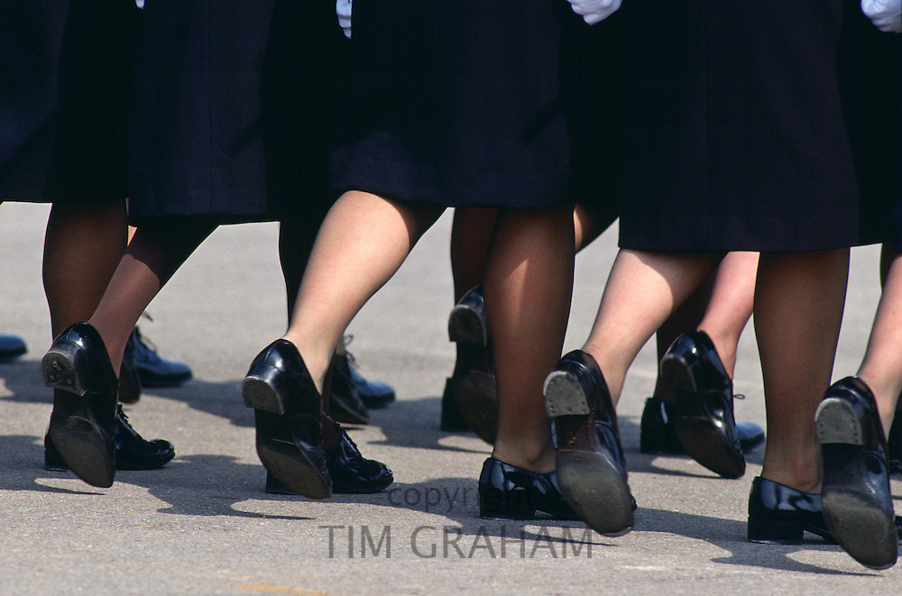 Female Soldiers march at Passing Out Parade, Sandhurst Royal Military Academy, Surrey, UK