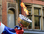 Lead float's torch during the Manchester Olympic Parade in Manchester, United Kingdom on 17 October 2016. Photo by Richard Holmes.